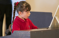 Why You Should Enroll Your Kids in Piano Lessons, According to Science